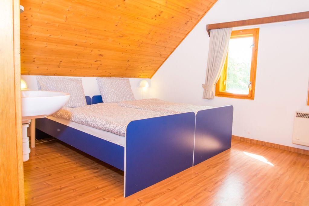 Slaapkamer in vakantiehuis in Tsjechië